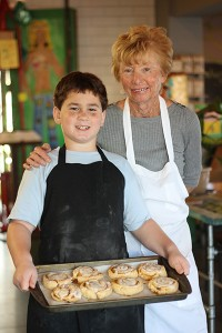 Chef Peggy and Logan with their famous cinnamon roles at Mead's Green Door Cafe in Orange.