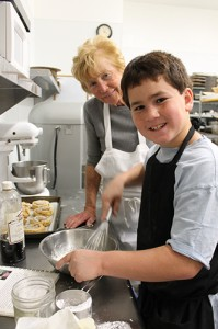 Chef Peggy is eagerly apprenticed by her grandson Logan.