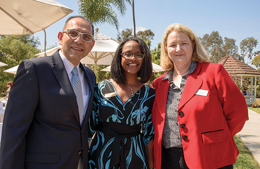 Community Service Programs' Huntington Beach Youth Shelter's Outstanding Service Award recipients, Attila Morgan and Bill Bejarano, with Executive Director of Community Service Programs Ronnetta Johnson